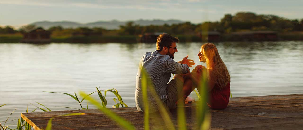 Couple sitting by the River at Tributary Park