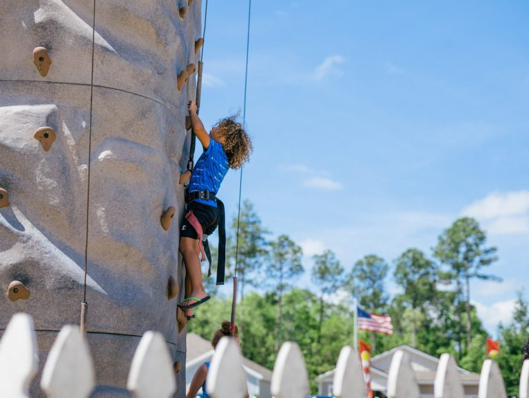kid rock climbing at Tributary Model Home Event