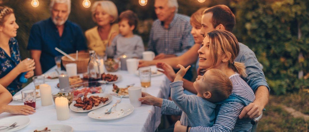 Family eating dinner outside at Tributary