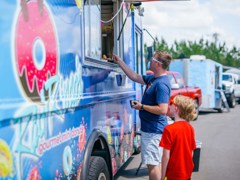 father and son at food truck at Tributary Model Home Event