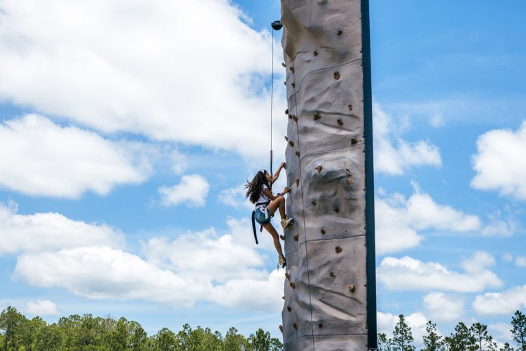 girl rock climbing at Tributary Model Home Event