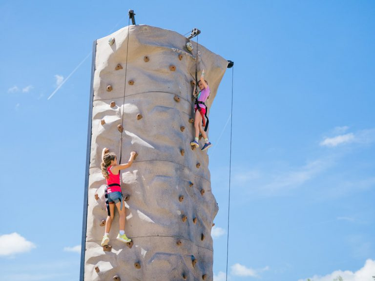 kids rock climbing at Tributary Model Home Event