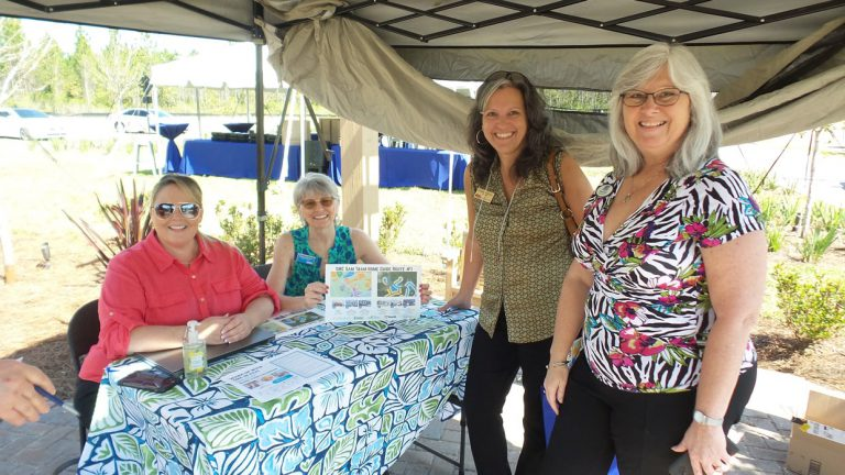 4 people smiling at Tributary Realtor Event