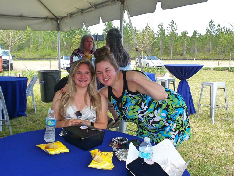 friends smiling at Tributary Model Home Event