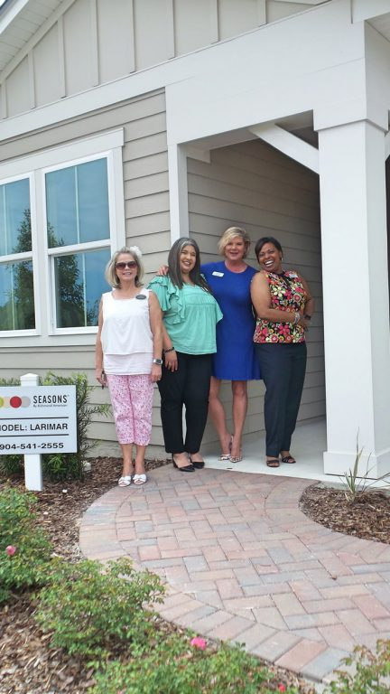 4 people outside of dream finders larimar model home at Tributary Model Home Event
