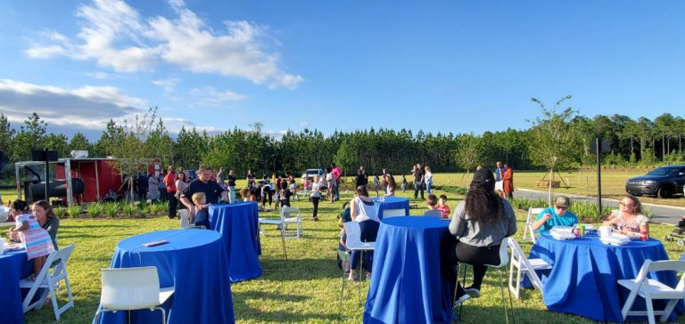 tables and people at the tributary homeowners event