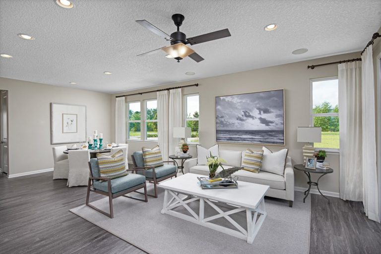 Richmond American Larimar furnished family room at Tributary